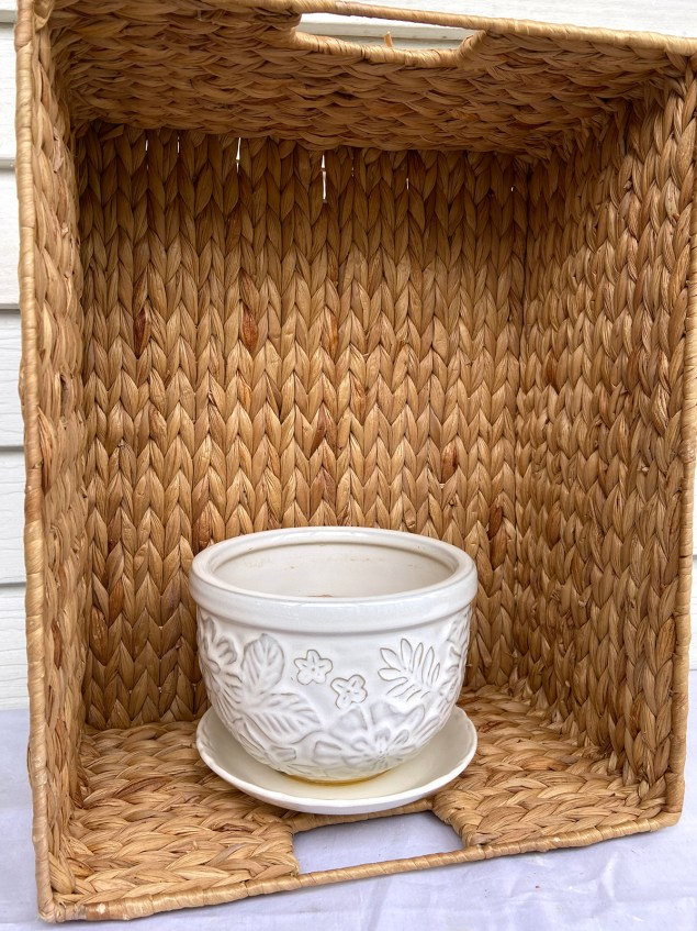 Woven basket with white pot inside