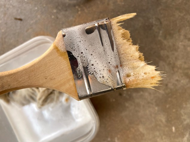old chip brush with over half of the bristles dissolved