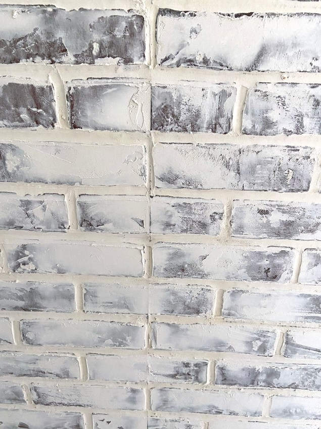 filling in the seam between faux brick wall panels