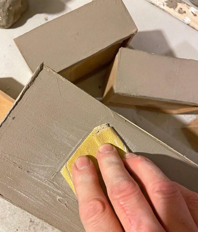 sanding ridges off concrete apothecary cabinet