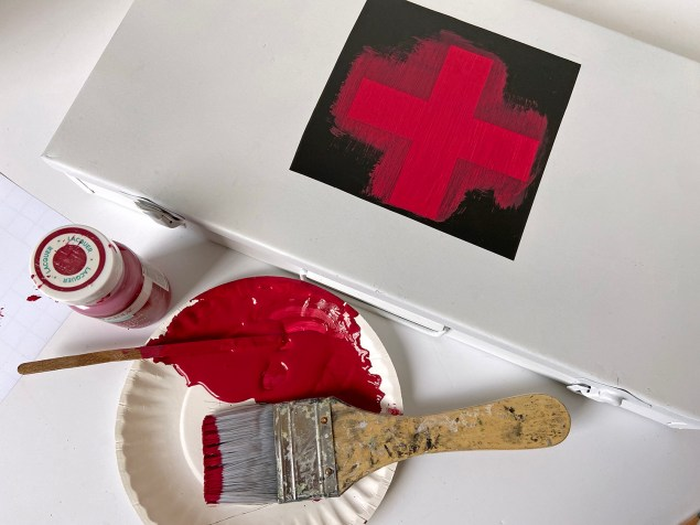 the red cross stencil after two coats of paint