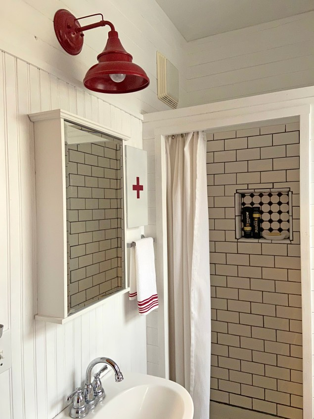 DIY vintage style first aid box in farmhouse bathroom