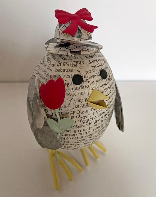 decoupaged newspaper chick