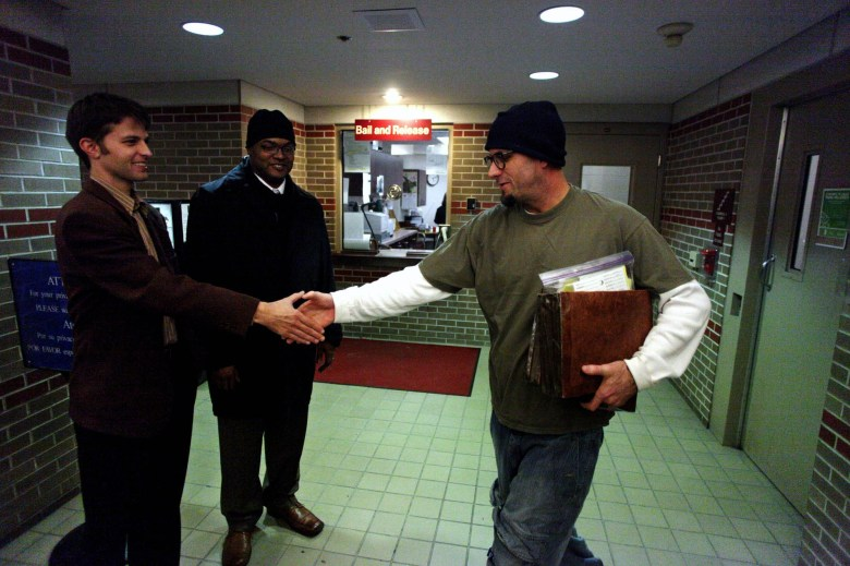 Forest Shomberg, right, walks to greet his attorney Byron Lichtstein, left, and law student Peter Middleton, center, both of the Wisconsin Innocence Project whose efforts were successful in overturning Shomberg's conviction on Nov. 13 in Dane County Circuit Court in Madison.  Shomberg had served more than six years in prison for a sexual assault that new DNA evidence indicates he did not commit. WISCONSIN STATE JOURNAL/CRAIG SCHREINER