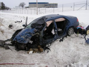 "A Whitewater woman died in this January 2009 crash on Highway 33 near the Dodge County Airport after her Honda Accord crossed the center line and struck an oncoming semi-trailer. Dodge County Sheriff Todd Nehls said his county consistently ranks among the top few Wisconsin counties in traffic fatalities, in part because of the number of vehicles traveling between Madison, Milwaukee and the Fox Valley. ""Our traffic counts are very high for a rural county,"" Nehls said.   Photo courtesy of the Dodge County Sheriff's Office"