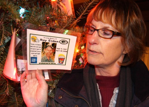 Karen Albrecht is pictured holding a picture of her brother, Raymond Eiden, who took his own life in April 2008. Wisconsin's suicide rate has been higher than the national rate for about a decade. WCIJ/JOSEPH W. JACKSON III