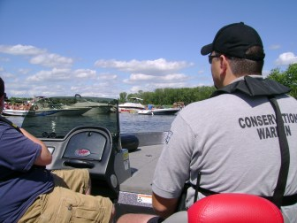 DNR conservation warden Nate Kroeplin approaches Gilligan's Island in the Yahara River, which connects Lake Monona to Lake Waubesa. A popular sandbar stop for boaters, the spot is a top site in the Dane County area for drunken boating arrests, Kroeplin said.