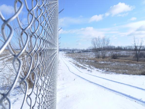 Waukesha County Airport's new fence, with deer habitat