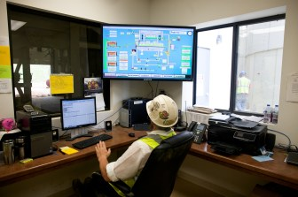 Moses Wengard monitors the processing operation at the Preferred Sands plant in Blair, Wis., on June 20, 2012.