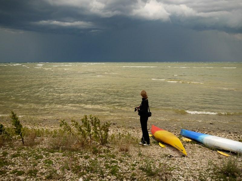 photographer standing by lake michigan