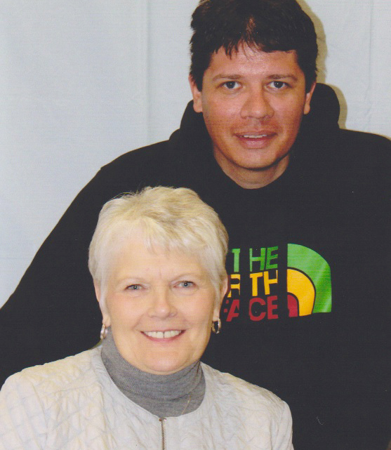"""Dianne Hendrickson and her son Eric, a sex offender confined to Sand Ridge Secure Treatment Center, inside the visiting area. The state committed Eric as a sexually violent person in 2002. The Hendricksons believe he has been denied discharge from the facility for rule infractions unrelated to the risk he poses to the community as a sex offender. Dianne Hendrickson is eager to see her son come home: """"I have never prayed or wished for anything more than that."""""""