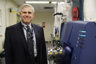 Doug Lewis, president and scientific director of U.S. Drug Testing Laboratories in Des Plaines, Ill., shows a triple quadrupole mass spectrometer, the equipment he uses to find minute traces of alcohol byproducts in fingernails from repeat drunken driving offenders.