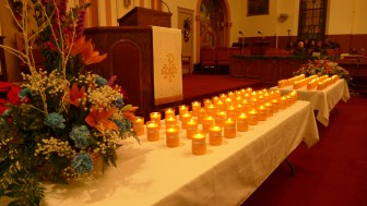 Candles with names attached, at a Dec. 30 memorial in Milwaukee for victims of gun violence there.