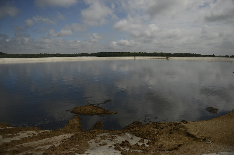 """A large lagoon holds manure on the Kinnard Farms in Kewaunee County. Last year, an administrative law judge accused the DNR of """"massive regulatory failure"""" for failing to prevent widespread contamination in the private water wells used by Kewaunee County residents living near large dairy farms."""