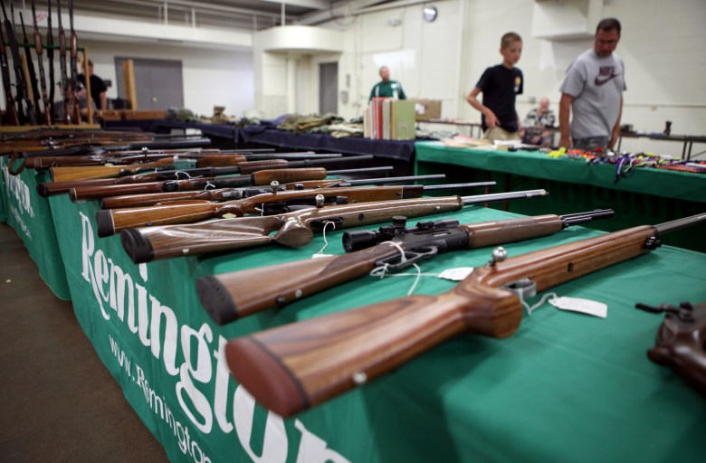 Rifles are seen on display at Ron Martin's booth at the Badger Military Collectible Show in Waukesha, on Aug. 5. Martin has been a licensed gun dealer for 33 years.