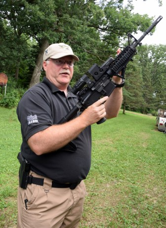 Curt La Haise is a shooting instructor, former police officer and a National Rifle Association member, seen here at his shooting range in Deerfield, Wis. La Haise is the owner of Guardian Safety & Security Solutions, which provides self-defense training. He holds a semi-automatic AR-15 rifle. Taken on July 30, 2016.