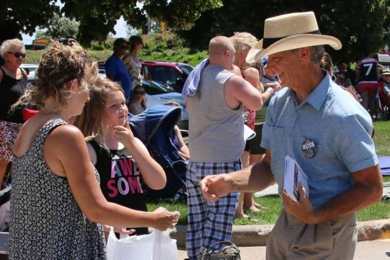 Organic farmer Russ Brown, who is challenging Rep. Scott Krug, R-Nekoosa, campaigns in Wisconsin Rapids during the Cranberry Blossom Festival Parade on June 19. Brown, a Democrat, and Krug agree water quality and quantity are key issues in the race for the 72nd Assembly District seat.