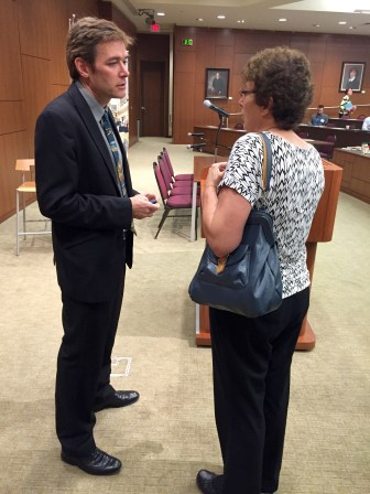 Virginia Tech University professor Marc Edwards talks with Milwaukee Water Works Superintendent Carrie Lewis before a symposium on drinking water Sept. 7, at Marquette University in Milwaukee, Wis. Edwards said Wisconsin's 176,000 lead service lines that deliver water to homes and business pose a serious danger to public health.