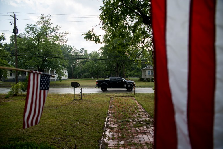 Residents in Sparta, Georgia, display American flags from their front porch on July 3, 2016. There have been 114 allegations of fraud investigated by the Georgia secretary of state since 2012. None of them involve voter impersonation, which is the type of fraud that voter ID laws are intended to prevent.