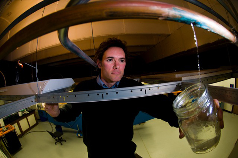 """Marc Edwards, a Virginia Tech engineering professor who is a national expert on lead in drinking water, collects a sample from a leaking water pipe. Edwards spoke Sept. 7, at a symposium in Milwaukee, saying the current federal law aimed at protecting the public from lead in drinking water is """"a total sick joke on the U.S. population."""""""
