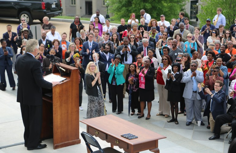 Virginia's Democratic Gov. Terry McAuliffe spoke to a gathered crowd in Richmond before signing a bill restoring voting rights to all Virginia felons on April 22, 2016. The bill was later struck down.