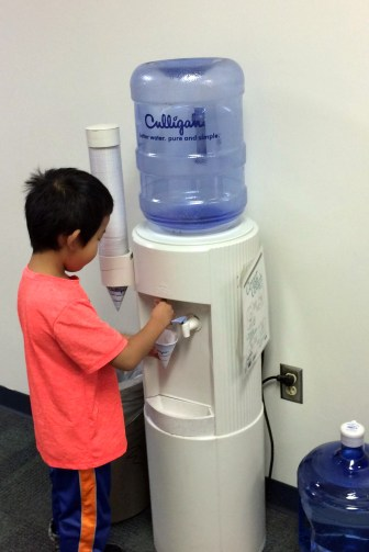 A child gets a drink from a water cooler at Riverside Elementary School east of Wausau on Dec. 7, 2016. More than 10 years ago, the school got rid of its drinking fountains and began providing water from coolers. The school also installed a filtration system after it discovered there were lead pipes in the building's foundation.