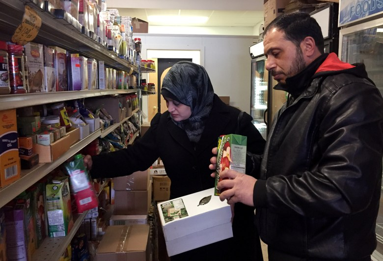 Syrian refugees Rula and Abdul shop at Istanbul Market in Madison, Wis. The couple arrived in Madison on Jan. 20, 2017 with their elementary-age daughters.
