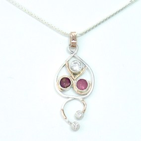 Sapphire and tourmaline birthstones with diamond in silver and gold
