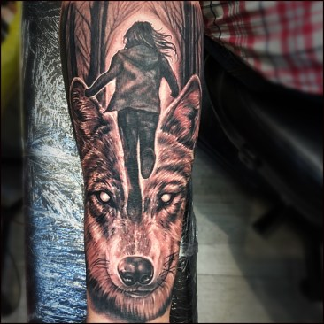Run wolf lady tattoo