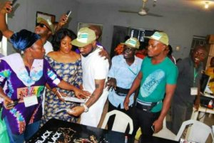 PHOTOS: Officials Gather To Take Selfies With Davido During His NYSC Registration In Lagos