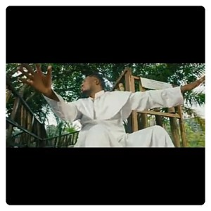 """Qdot Alagbe in white garment on the music video for """"Jegele"""""""