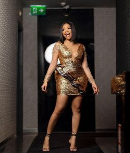 Nengi BBN in short golden dress and laughing