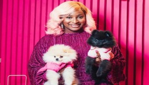 Watch DJ Cuppy Tongue Kissing Her Dog (Video)