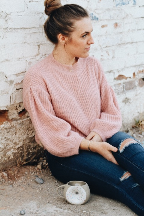 feminine winter outfit pink sweater
