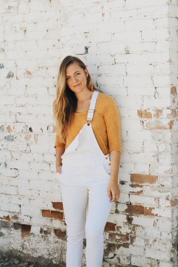 last thing you should be doing white overalls outfit mustard top
