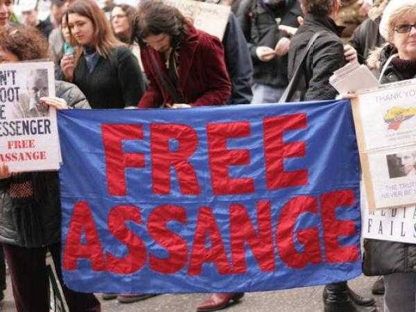 March march FREE ASSANGE banner