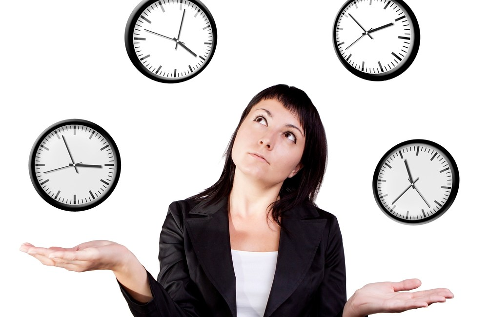 Businesswoman juggling clocks. Time management for creatives and experts.