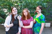 Photo of Erin Venable, Claire McCrea, and Rory Nachbar, with dog ear props.
