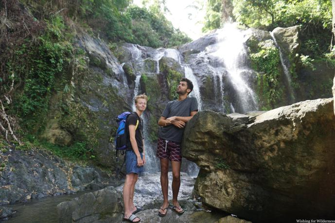 Standing in front of waterfalls in Trinidad