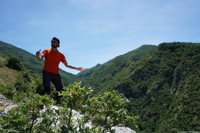 standing on a mountain