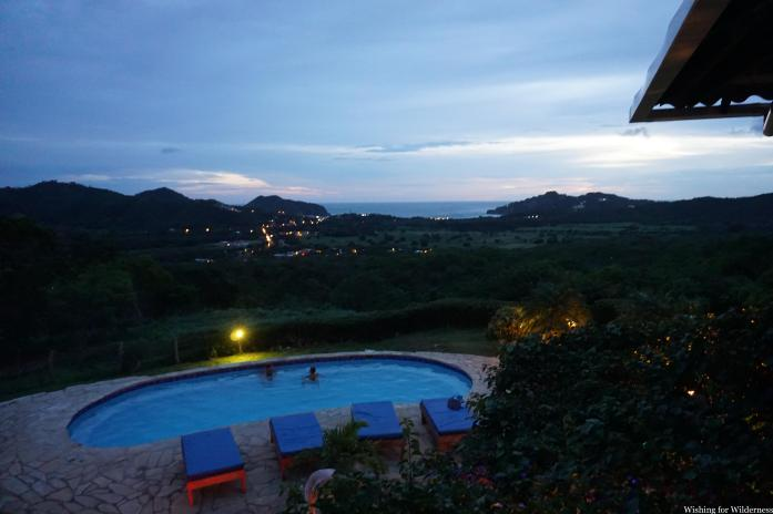 A pool looking over a bay at sunset Nicaragua