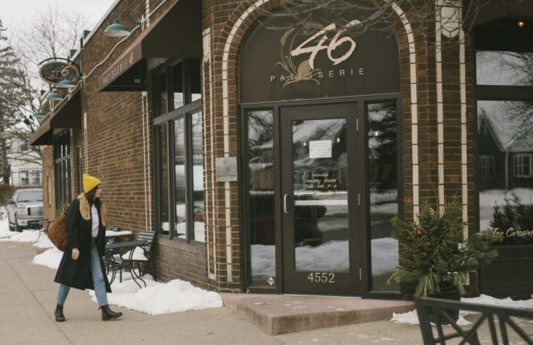 Kate Arends walking into coffee shop Wit & Delight