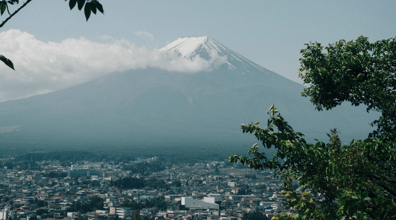 Mount Fuji over a city