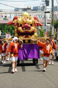 people participating in tsukiji lion dance festival