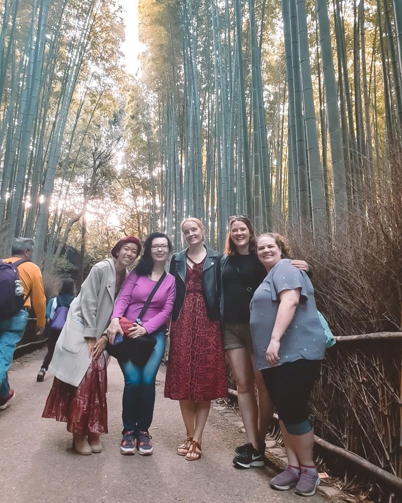 women smiling in bamboo grove