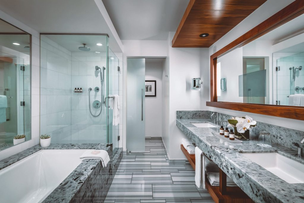 Large marble bathroom with tub