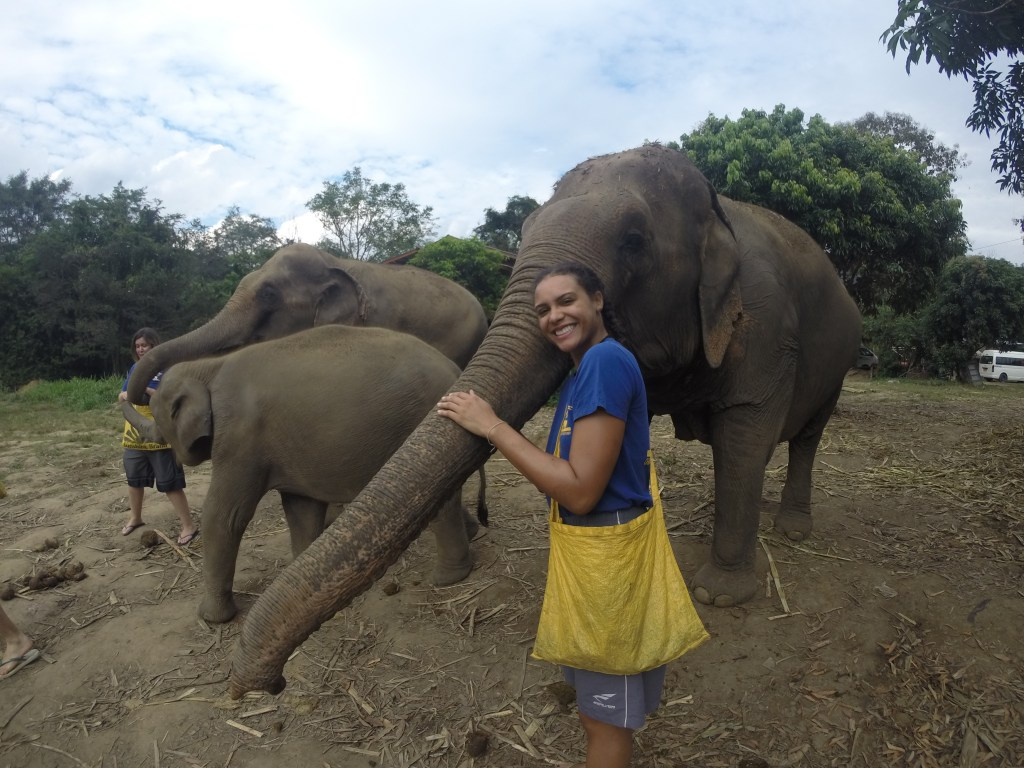 Me happily hugging an elephant's trunk at Chiang Mai Mountain Sanctuary for elephants in Chiang Mai, Thailand.
