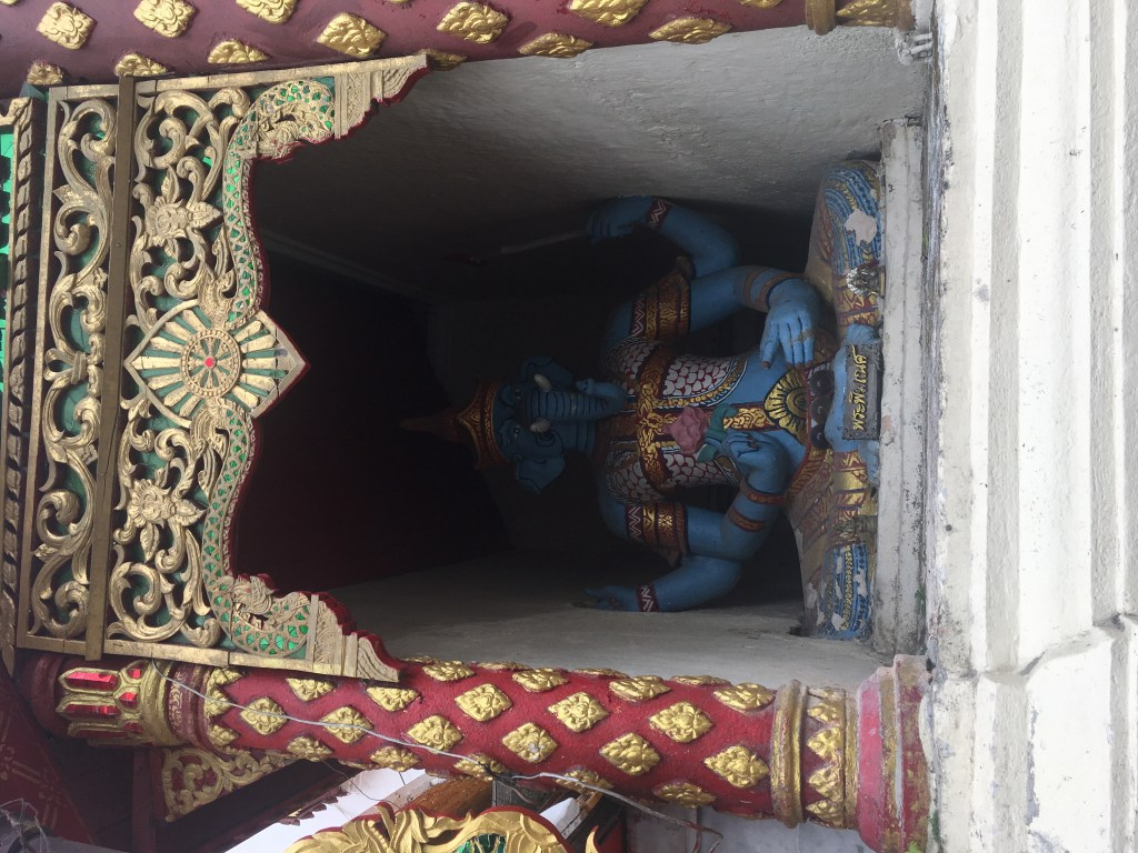 Statue of Ganesh the elephant god under archway at Wat Doi Suthep in Chiang Mai, Thailand.