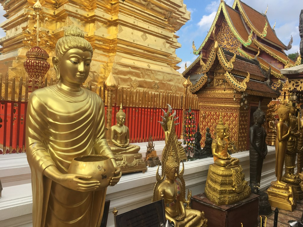 Gold statues at Wat Doi Suthep in Chiang Mai, Thailand.
