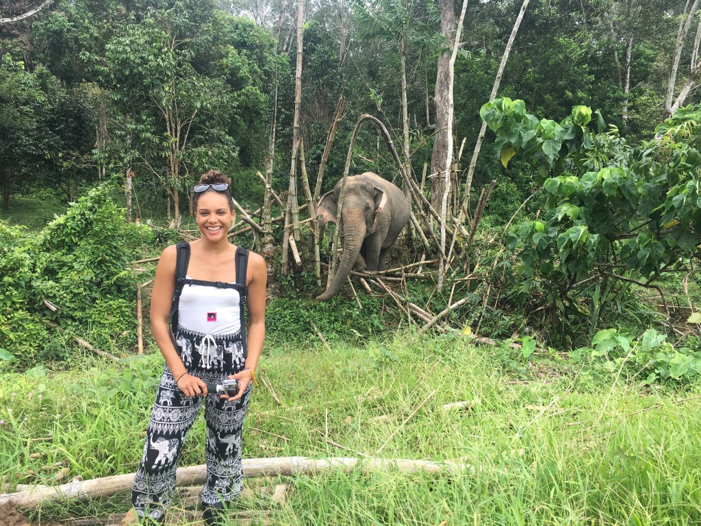 Me standing with elephant in background at Phuket Elephant Sanctuary in Phuket, Thailand